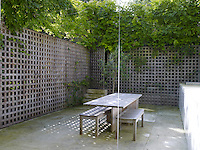 The courtyard garden is very much an extension of the kitchen and designed as an alternative dining area when the weather is fine