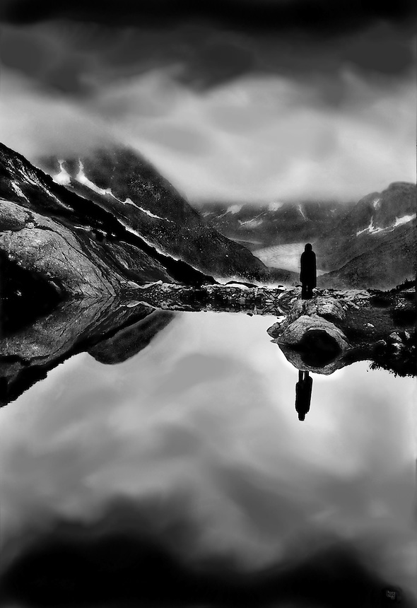 A person stands with reflection in french alps