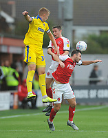 Fleetwood Town's Jordan Rossiter and Lewis Coyle vie for possession with AFC Wimbledon's Joe Pigott<br /> <br /> Photographer Kevin Barnes/CameraSport<br /> <br /> The EFL Sky Bet Championship - Fleetwood Town v AFC Wimbledon - Saturday 10th August 2019 - Highbury Stadium - Fleetwood<br /> <br /> World Copyright © 2019 CameraSport. All rights reserved. 43 Linden Ave. Countesthorpe. Leicester. England. LE8 5PG - Tel: +44 (0) 116 277 4147 - admin@camerasport.com - www.camerasport.com