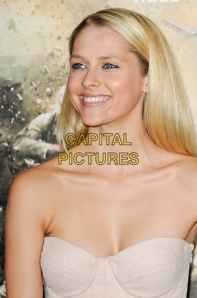 "TERESA PALMER.The Los Angeles premiere of HBO's new miniseries event ""The Pacific"" at Grauman's Chinese Theatre in Hollywood, California.  .February 24th, 2010.headshot portrait cleavage top pink white beige strapless bustier corset headshot portrait .CAP/ROT.©Lee Roth/Capital Pictures"