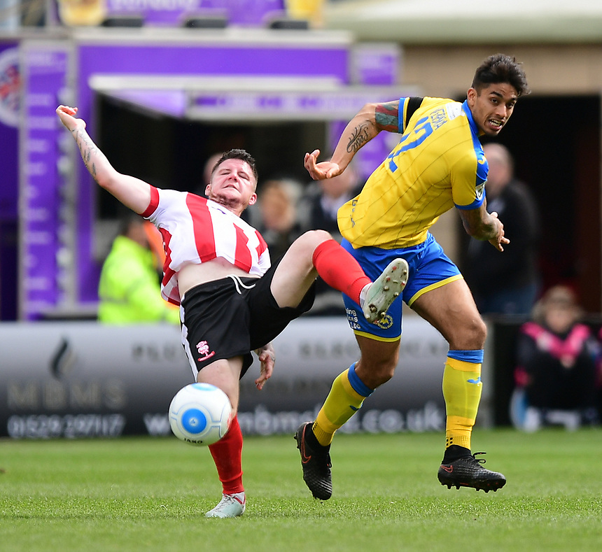 Lincoln City's Billy Knott vies for possession with Torquay United's Aman Verma<br /> <br /> Photographer Chris Vaughan/CameraSport<br /> <br /> Vanarama National League - Lincoln City v Torquay United - Friday 14th April 2016  - Sincil Bank - Lincoln<br /> <br /> World Copyright &copy; 2017 CameraSport. All rights reserved. 43 Linden Ave. Countesthorpe. Leicester. England. LE8 5PG - Tel: +44 (0) 116 277 4147 - admin@camerasport.com - www.camerasport.com
