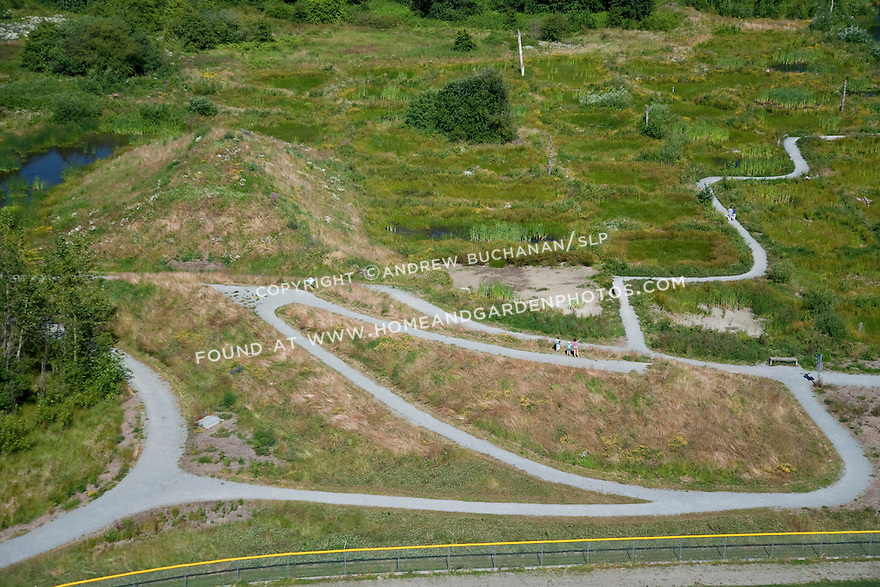 """aerial photo of Magnuson Park, on the site of the former Sand Point Naval Air Station; here, """"the berm"""" provides a view point across, and walking trails provide access through, the new wetlands and water management ponds; Seattle, WA; July, 2011"""
