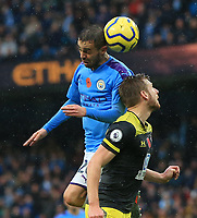 2nd November 2019; Etihad Stadium, Manchester, Lancashire, England; English Premier League Football, Manchester City versus Southampton; Bernardo Silva of Manchester City winsa header challenged by Stuart Armstrong of Southampton - Strictly Editorial Use Only. No use with unauthorized audio, video, data, fixture lists, club/league logos or 'live' services. Online in-match use limited to 120 images, no video emulation. No use in betting, games or single club/league/player publications