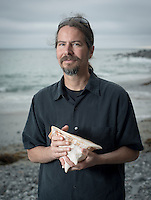 Joseph Schulz, associate professor of biology, Doheny State Beach, June 14, 2015. Schulz is in charge of the Dieter Cosman Shell Collection, a large private collection of gastropod shells and bivalves donated to Oxy.<br /> (Photo by Marc Campos, Occidental College Photographer)