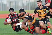 Lage Fasavalu is taken to ground by Tuise Toai-Key. Counties Manukau Premier Club Rugby game between Papakura and Bombay, played at Massey Park Papakura on Saturday June 16th 2018. Bombay won the game 36 - 17 after leading 17 - 7 at halftime.<br /> Papakura Ray White 17 - Kris Smithson 2, Taafaga Tagaloa tries, Monty Punatai conversion.<br /> Bombay 36 - Jordan Goldsmith, Haamiora Clarke 2, Patrick Masoe, Mitchell Thackham, Chay Mackwood tries, Jordan Goldsmith 2, Ki<br /> Anufe conversions.<br /> Photo by Richard Spranger.