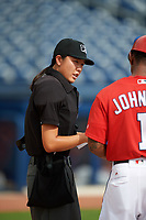 Home plate umpire Emma Charlesworth-Seiler goes over the ground rules with manager Josh Johnson (right) during the lineup exchange before the first game of a doubleheader between the GCL Mets and GCL Nationals on July 22, 2017 at The Ballpark of the Palm Beaches in Palm Beach, Florida.  GCL Mets defeated the GCL Nationals 1-0 in a seven inning game that originally started on July 17th.  (Mike Janes/Four Seam Images)