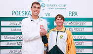(L) Jerzy Janowicz of Poland & (R) Rik de Voest of South Africa while official draw one day before the BNP Paribas Davis Cup 2013 between Poland and South Africa at MOSiR Hall in Zielona Gora on April 04, 2013...Poland, Zielona Gora, April 04, 2013..Picture also available in RAW (NEF) or TIFF format on special request...For editorial use only. Any commercial or promotional use requires permission...Photo by © Adam Nurkiewicz / Mediasport