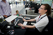 Young girl and her father check-in for a British Airways flight at Heathrow Airport's Terminal 5.