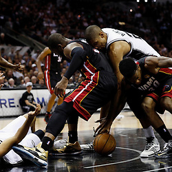 Jun 13, 2013; San Antonio, TX, USA; San Antonio Spurs power forward Tim Duncan (21) and Miami Heat shooting guard Dwyane Wade (3) and Miami Heat power forward Udonis Haslem (right) and San Antonio Spurs point guard Tony Parker (9) go after a loose ball during the second quarter of game four of the 2013 NBA Finals at the AT&T Center. Mandatory Credit: Derick E. Hingle-USA TODAY Sports