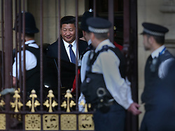 © Licensed to London News Pictures. 20/10/2015. London, UK. Police watch as Chinese President Xi Jinping (C) leaves Parliament by the  Sovereign's Entrance. Photo credit: Peter Macdiarmid/LNP