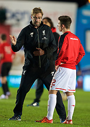 EXETER, ENGLAND - Friday, January 8, 2016: Liverpool's manager Jürgen Klopp talks to Cameron Brannagan before the FA Cup 3rd Round match against Exeter City at St. James Park. (Pic by David Rawcliffe/Propaganda)