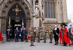 "© Licensed to London News Pictures. 27/10/2018. Bristol, UK. The Royal British Legion launch this year's Bristol Poppy Appeal, ""One thousand poppies, for one hundred years, for one million lives"" at Bristol Cathedral. For the launch of the 2018 Bristol Poppy Appeal at 11am on 27 October, the Royal British Legion recreated a scene from the end of WW1 outside Bristol Cathedral on College Green, and Colonel Clive Fletcher-Wood read the war poem In Flanders Fields. They were joined by Civic Dignitaries Peaches Golding the Lord Lieutenant of Bristol, City of Bristol High Sheriff Mr Roger Opie (pictured), and Bristol's Lord Mayor Cleo Lake (pictured). A Bugler and the Bristol Military Wives Choir performed songs from their new album 'Remember'. Staff at MOD Filton filled 400 sandbags with eight tonnes of sand to build trenches and recreate 'Flanders Fields' and planted over 1000 waterproof poppies on College Green. Poppies and sandbags can be sponsored by individuals wanting to remember those who fought and died in conflict. There were re-enactors in WW1 uniform from Somerset Light Infantry (known as the West Country Tommys), as well as medics and nurses with equipment from the time. Bristol's own 'War Horse' (Buzz from Blagdon Horsedrawn Carriages) was on College Green behind the improvised barbed wire to represent the 350,000 horses that left Avonmouth for the frontline during WW1. There are also 10,000 knitted poppies on display both in and outside Bristol Cathedral following 'The Charfield Yarn Bombers' incitement to locals to get knitting to mark the occasion, with a display inside the Cathedral organised by Helen Date. Photo credit: Simon Chapman/LNP"