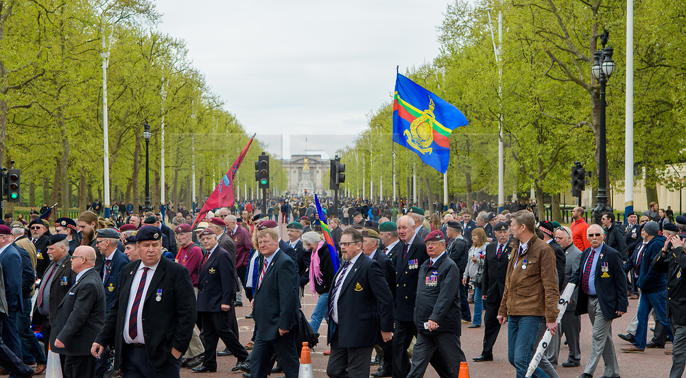 © Licensed to London News Pictures. <br /> 14/4/2017. London, Great Britain. <br /> Veterans march across the Mall with Buckingham Palace in the background during the Justice for Northern Ireland Veterans March in central London.<br /> They are protesting the prosecution of former Service men and women who served in Northern Ireland during the Troubles.<br /> Photo credit: Anthony Upton/LNP