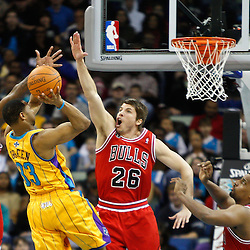February 12, 2011; New Orleans, LA, USA; New Orleans Hornets shooting guard Willie Green (33) shoots over Chicago Bulls shooting guard Kyle Korver (26) and shooting guard Ronnie Brewer (11) during the fourth quarter at the New Orleans Arena.  The Bulls defeated the Hornets 97-88. Mandatory Credit: Derick E. Hingle