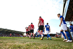 Lincoln City and Sheffield Wednesday walk out for the preseason friendly at Sincil Bank - Mandatory by-line: Robbie Stephenson/JMP - 13/07/2018 - FOOTBALL - Sincil Bank Stadium - Lincoln, England - Lincoln City v Sheffield Wednesday - Pre-season friendly
