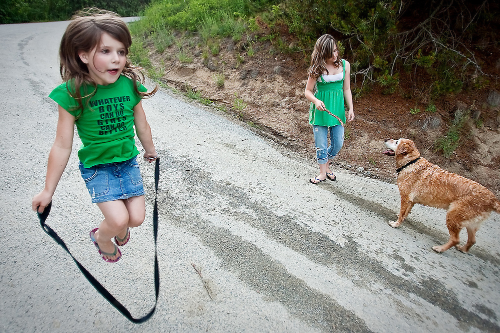 Rheana jumping with B.B.'s dog leash while Felicia plays stick with her at the Hayden Lake sportsman's access Saturday, June 20, 2009. Felicia's also played with a dead fish this day. We celebrated Father's Day this day because I had to shoot Ironman the next day.