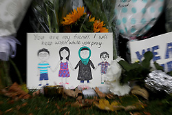March 18, 2019 - Christchurch, New Zealand - Flowers and messages of condolence to victims of the mosque attacks are seen on a wall at the Botanical Gardens in Christchurch on March 17, 2019. At least 50 people were killed and 36 injured in mass shootings at two mosques in the New Zealand city of Christchurch Friday, 15 March. A 28-year-old Australian born man appeared in Christchurch District Court on Saturday charged with murder. (Credit Image: © Sanka Vidanagama/NurPhoto via ZUMA Press)