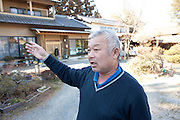 Nuclear Exclusion zone.   Just a  few Kilometers from he  stricken Fukushima Power Plant. A few residents defying orders form the  Government are returning to their homes. Most house suffered only  minor damage form the  Quake and Tsunami. Towns that  are within  the 20km  Zone considered dangerous  from possible  Additional Leaks  of air born Emissions form the  Damaged  Reactors.