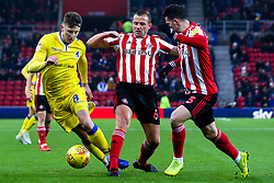 Ollie Clarke of Bristol Rovers takes on Lee Cattermole and Bryan Oviedo of Sunderland - Mandatory by-line: Robbie Stephenson/JMP - 15/12/2018 - FOOTBALL - Stadium of Light - Sunderland, England - Sunderland v Bristol Rovers - Sky Bet League One