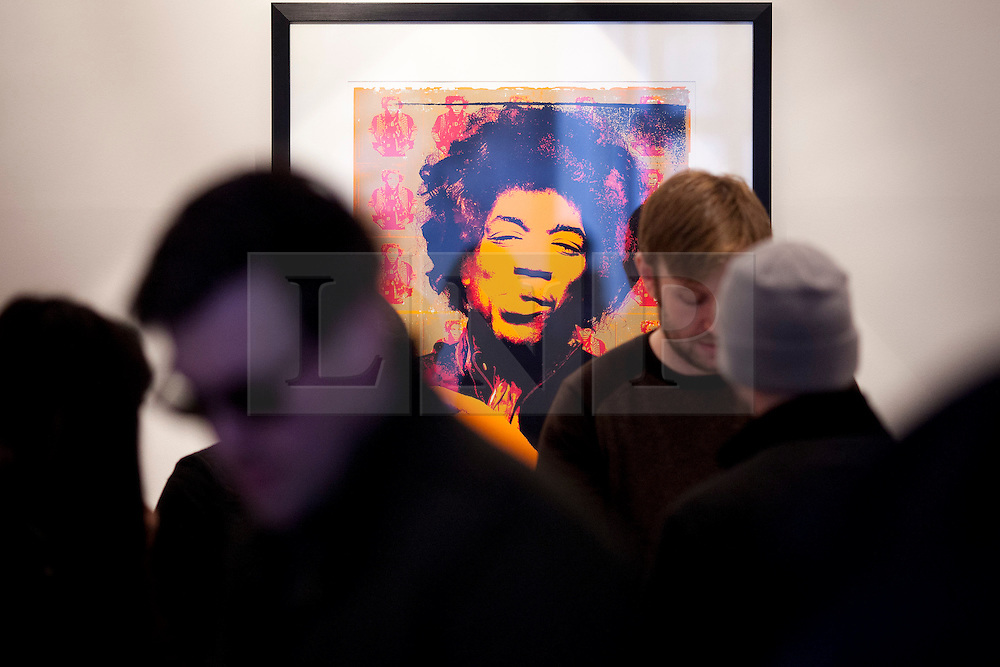 © Licensed to London News Pictures. 02/04/2013. London, UK. Jimi Hendrix fans browse merchandise in a pop-up shop set up to celebrate a new album by the late guitar legend in London today (02/04/2013). The shop, called 'People, Hell and Angels', located near London's Carnaby Street, runs from the 1st of April until the 12th of April 2013 and features memorabilia, music and photographs of the guitarist and singer who died in 1970 of a drug overdose. Photo credit: Matt Cetti-Roberts/LNP