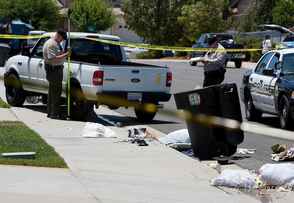 /Andrew Foulk/ For The Californian/.Temecula police, take measurements  near a white Ford Ranger that rests on the sidewalk of the 32000 block of .Via Cordoba in Temecula Monday afternoon. The vehicle struck and gravely injured an 87-year-old woman, and killed her dog as she stood on the sidewalk speaking to a neighbor. After the truck struck the woman and her dog it hit two trash cans before coming to rest on the curb in a neighboring driveway. The driver a 55-year-old Temecula man was taken to South West detention center for questioning.