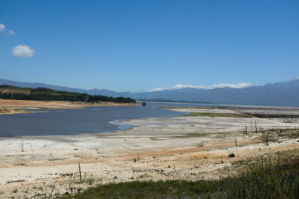 Theewaterskloofdam looking South. The Southern end of the dam is extremely shallow and water evaporation is accelerated especially in summer. Sixty percent of the water in Theewaterskloof dam is reportedly earmarked for the meag-export fruit agriculture industry surrounding the dam. March 2018.