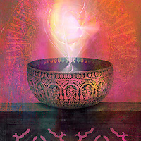 Ancient metal bowl from India inscribed with spiritual symbolism and filled with light energy.<br />
