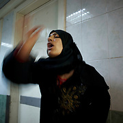 August 10, 2012 - Aleppo, Syria: A syrian woman reacts in shock to the death of a family member, killed minutes after heavy shelling from the Syrian Army against a bakery in the residential area of Tariq Al-Bab in central Aleppo. At least 12 people have died and more the 20 got injured during the attack...The Syrian Army have in the past week increased their attacks on residential neighborhoods where Free Syria Army rebel fights have their positions in Syria's commercial capital, Aleppo.