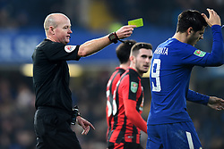 December 20, 2017 - London, England, United Kingdom - Chelsea Forward Alvaro Morata is shown a yellow card for dissent by Referee Lee Mason during the Carabao Cup Quarter - Final match between Chelsea and AFC Bournemouth at Stamford Bridge, London, England on 20 Dec 2017. (Credit Image: © Kieran Galvin/NurPhoto via ZUMA Press)