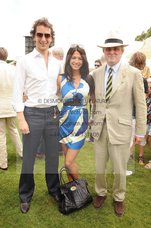 Left to right, The HON.WILL ASTOR, his wife LOHARLEE and VISCOUNT ASTOR at a luncheon hosted by Cartier for their sponsorship of the Style et Luxe part of the Goodwood Festival of Speed at Goodwood House, West Sussex on 4th July 2010.