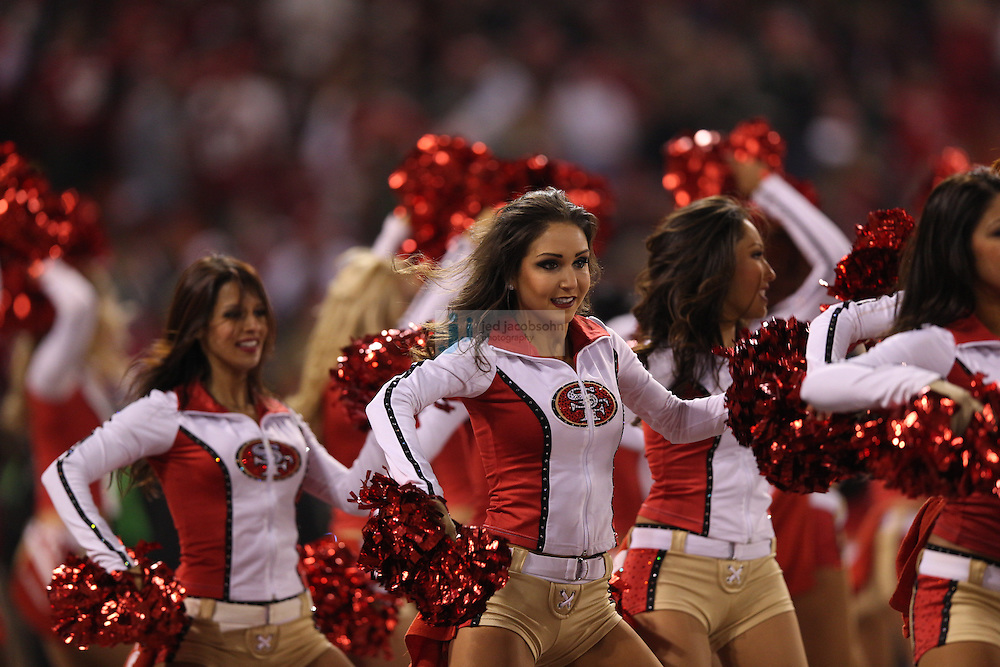 Cheerleaders perform during a NFL Divisional playoff game against the Green Bay Packers and the San Francisco 49ers at Candlestick Park in San Francisco, Calif., on Jan. 12, 2013. The 49ers defeated the Packers 45-31. (AP Photo/Jed Jacobsohn)
