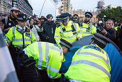 London, UK. 9 October, 2019. Police officers using Section 14 of the Public Order Act 1986 arrest an Extinction Rebellion climate activist from a tent pitched in the road in Parliament Square on the third day of International Rebellion protests to demand a government declaration of a climate and ecological emergency, a commitment to halting biodiversity loss and net zero carbon emissions by 2025 and for the government to create and be led by the decisions of a Citizens' Assembly on climate and ecological justice.