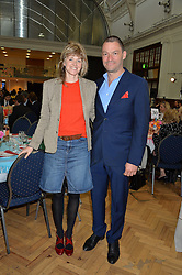 DOMINIC WEST and his wife CATHERINE at a lunch in aid of the charity African Solutions to African Problems (ASAP) held at the Royal Horticultural Hall, Vincent Square, London on 19th May 2016.