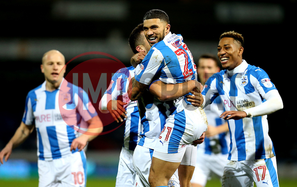 Tommy Smith of Huddersfield Town celebrates with Nahki Wells after scoring the opening goal against Brighton & Hove Albion - Mandatory by-line: Robbie Stephenson/JMP - 02/02/2017 - FOOTBALL - John Smith's Stadium - Huddersfield, England - Huddersfield Town v Brighton and Hove Albion - Sky Bet Championship