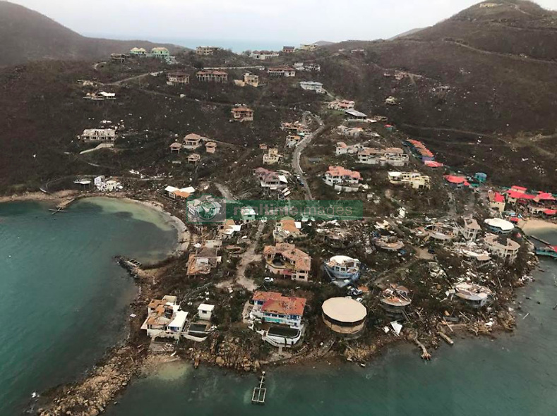 These dramatic aerial photos show the devastation caused across the British Virgin Islands after it was pummeled by Hurricane Irma last week. The deadly hurricane obliterated everything in its path, slamming boats into a huge cluster, tearing up homes and jetties and snapping trees and infrastructure into pieces. The current death toll in the Caribbean was reported at 38 on Monday [September 11]. Caribbean Buzz Helicopters took to the skies to takes these images the day after Irma made landfall across the British Virgin Islands. Areas photographed include Leverick Bay in Virgin Gorda, one the the neighboring islands to Richard Branson's privately-owned Necker Island, which was almost entirely destroyed by Irma, which is the most powerful hurricane ever recorded to have crossed the Atlantic Ocean. Another image depicts the jetty at Yacht Club Costa Smeralda which has been torn into pieces. After hitting the Caribbean on Wednesday [September 6], the hurricane continued its deadly path into Cuba and made landfall on the Florida Keys on Sunday [September 10] before pushing up the Gulf Coast. On Monday [September 11] it was downgraded to a tropical storm, but is still pummeling northern Florida and is expected to hit Georgia later today. Latest figures reveal the death toll has risen to 38 in the Caribbean while five deaths so far have been reported in Florida. 11 Sep 2017 Pictured: Devastation caused by Hurricane Irma in the British Virgin Islands - Leverick Bay. Photo credit: Caribbean Buzz/ MEGA TheMegaAgency.com +1 888 505 6342