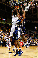 November 16th, 2013:  Colorado Buffaloes redshirt freshman forward Wesley Gordon (1) attempts a shot over Jackson State Tigers freshman guard  Javeres Brent (20) in the first half of the NCAA Basketball game between the Jackson State Tigers and the University of Colorado Buffaloes at the Coors Events Center in Boulder, Colorado