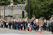 Protesters march past Cardiff Castle during the Black Lives Matter protest in Cardiff, Wales on 6 June 2020.
