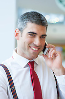 Close-up of businessman smiling on mobile phone