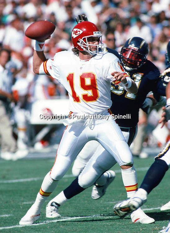 Kansas City Chiefs quarterback Joe Montana (16) throws a pass while pressured from behind during the NFL football game against the San Diego Chargers on Oct. 17, 1993 in San Diego. The Chiefs won the game 17-14. (©Paul Anthony Spinelli)