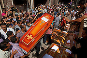 Egyptian Coptic Christians prepare caskets for victims of sectarian violence October 10, 20011 at the Coptic Hospital in Cairo, Egypt. At least 26 people, mostly Christian, were killed during sectarian clashes that saw the worst violence since the Revolution that toppled former Egyptian president Hosni Mubarak earlier this year. Egyptian Coptic Christians make up about 10% of Egypt's 80 million population and periodically violence flares between the Christian minority and the majority Muslim population. (Photo by Scott Nelson)