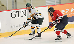 PITTSBURGH, PA - OCTOBER 15:  Bridget Baker #16 of the Vermont Catamounts handles the puck in front of Brittany Howard #3 of the Robert Morris Colonials in the first period during the game at 84 Lumber Arena on October 15, 2016 in Pittsburgh, Pennsylvania. (Photo by Justin Berl)