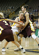 25 JANUARY 2007: Iowa guard Kristi Smith (11) tries to drive in between Minnesota guard Kelly Roysland (3) and guard Brittany McCoy (12) in Iowa's 80-78 overtime loss to Minnesota at Carver-Hawkeye Arena in Iowa City, Iowa on January 25, 2007.