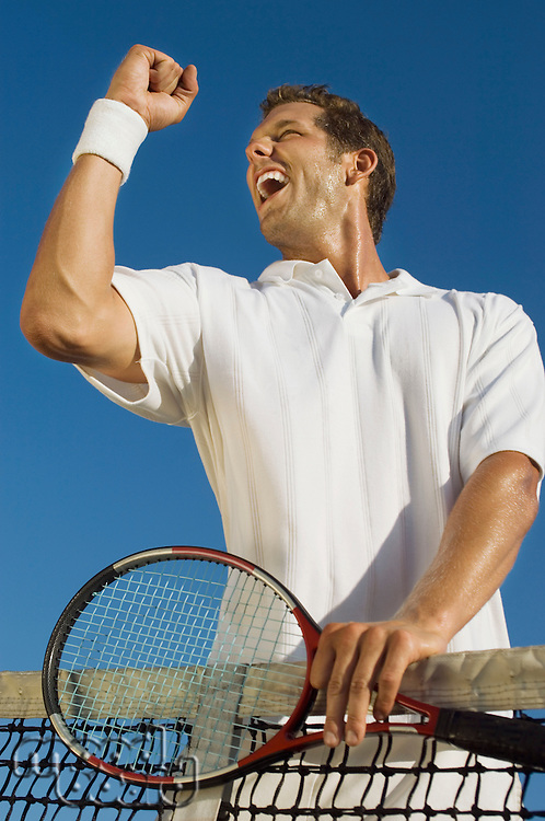 Tennis Player Pumping His Fist at Net