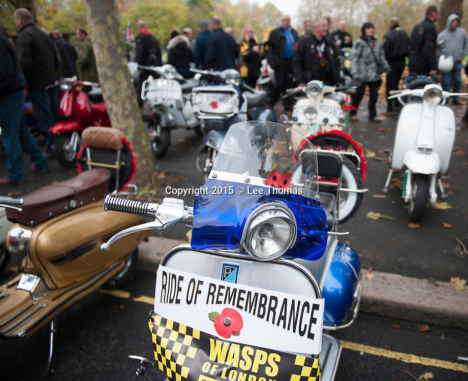 Eel Brook Pub, New Kings Road, Fulham, London, UK. 8th November, 2015.  Up to a thousand scooter riders congregate in West London on Remembrance Sunday to take part in the annual Ride of Remembrance. The Wasps of London Scooter Club paid their respects to the fallen by holding a two minute silence at 11AM near to Eal Brook Common before embarking on their ride to The Royal Artillery Memorial at Hyde Park Corner in central London.  This year's event marks the eighth time the scooter club's Ride of Remembrance has been organised and they are hoping to break last year's record of one thousand plus scooters attending. Pictured:  Scooters embellished with poppies, wreaths and banners of respect are parked up near to Eal Brook Common.  // Lee Thomas, Flat 47a Park East Building, Bow Quarter, London, E3 2UT. Tel. 07784142973. Email: leepthomas@gmail.com. www.leept.co.uk (0000635435)