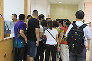 JINGZHOU, CHINA - JUNE 02: (CHINA OUT) <br /> <br /> People wait at Oriental Shipping Company in Chongqing for their relatives who took passenger ship Dongfangzhixing (Eastern Star) for Chongqing and the ship sank on Monday night in Jianli section of the Yangtze River on June 2, 2015 in Chongqing, China. A passenger ship named Dongfangzhixing (Eastern Star) carrying 458 people, including 406 Chinese passengers, 5 travel agency workers and 47 crew members aboard, according to the administration, sank at around 9:28 p.m. on Monday in the Jianli (Hubei Province) section of the Yangtze River. The ship headed for Chongqing from Nanjing and the captain and the chief engineer in thirty five people have been rescued and both claimed that the ship sank quickly after being attacked by cyclone. Chinese President Xijinping has ordered a work team of the State Council to rush to the site to guide search and rescue work, and rescue teams of Hubei, Chongqing and relevant parties to carry out all-search efforts and properly handle the aftermath.<br /> ©Exclusivepix Media
