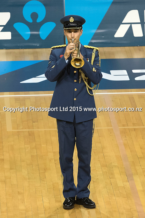 A bugler plays the last post as netball remembers ANZAC Day during the ANZ Championship - Pulse v Swifts netball match at the TSB Arena in Wellington on Saturday the 25th of April 2015. Photo by Marty Melville / www.Photosport.co.nz