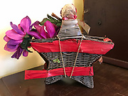 Hanging star basket from inside grocery 9 in by 9 in brown with red tape<br />