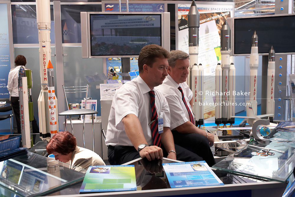 Delegates of the Moscow Khrunichev Space Center await new business at the Paris Air Show exhibition at Le Bourget airfield
