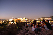 Filopappou Hill (Hill  of the Muses) in Athens, Greece is a popular place to watch the sunset over Athens and the Acropolis.