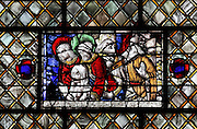 Fragment of the resurrection of Lazarus, late 15th - early 16th century, reconstructed 1840 and incorporated into a 1924 grisaille window in the transept of Chartres Cathedral, Eure-et-Loir, France. Chartres cathedral was built 1194-1250 and is a fine example of Gothic architecture. Most of its windows date from 1205-40 although a few earlier 12th century examples are also intact. It was declared a UNESCO World Heritage Site in 1979. Picture by Manuel Cohen